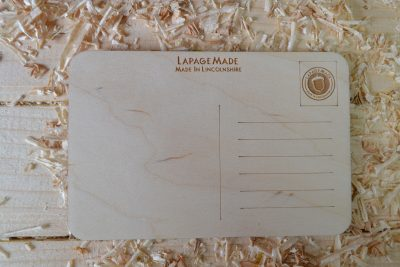 The backing to a wooden postcard.