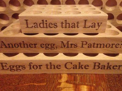 A selection of 2's, 6's, 12's & 18 Egg Holders with personalised Unique To Shop sayings and font.